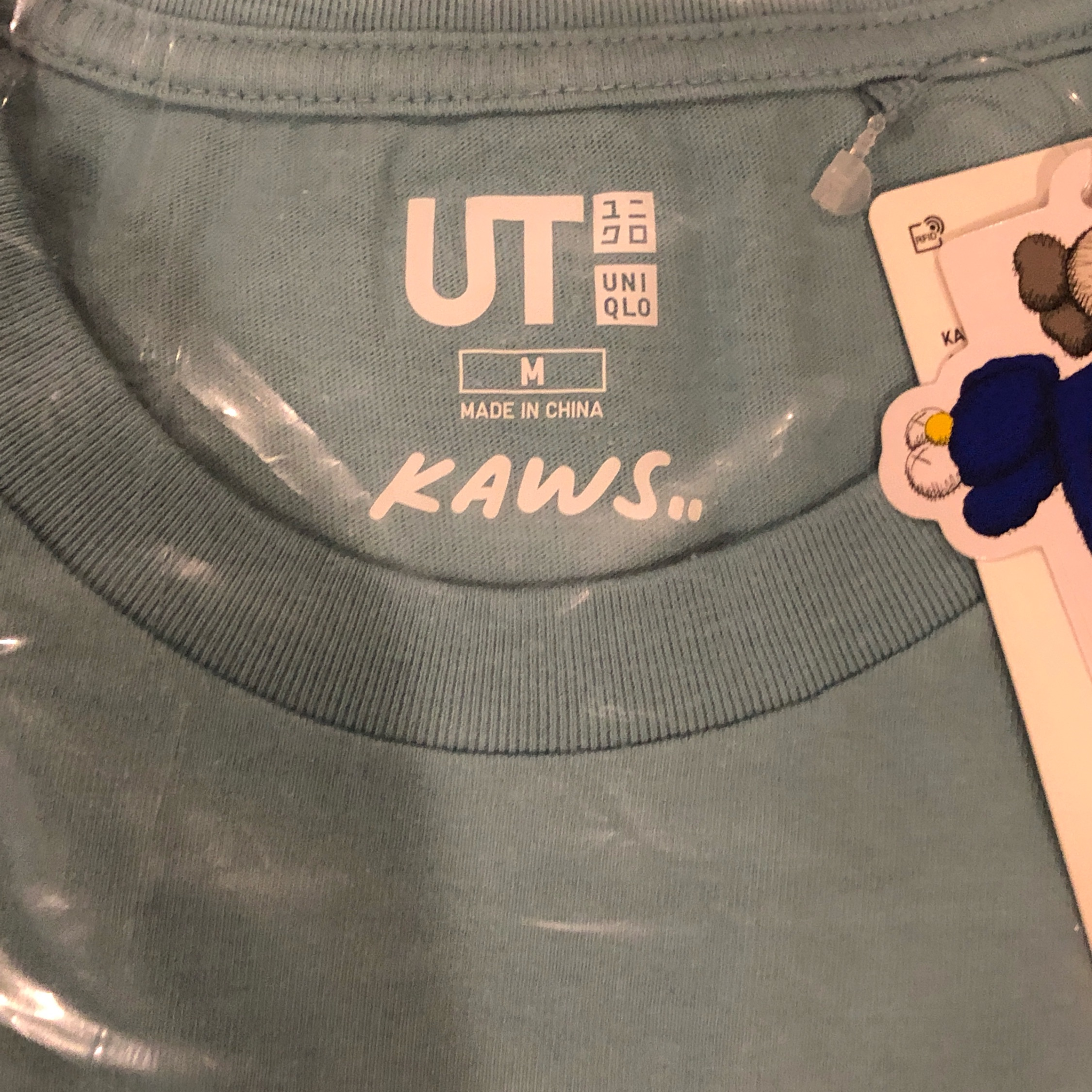 Last Kaws X Uniqlo Collab (1) Green With Blue Bff