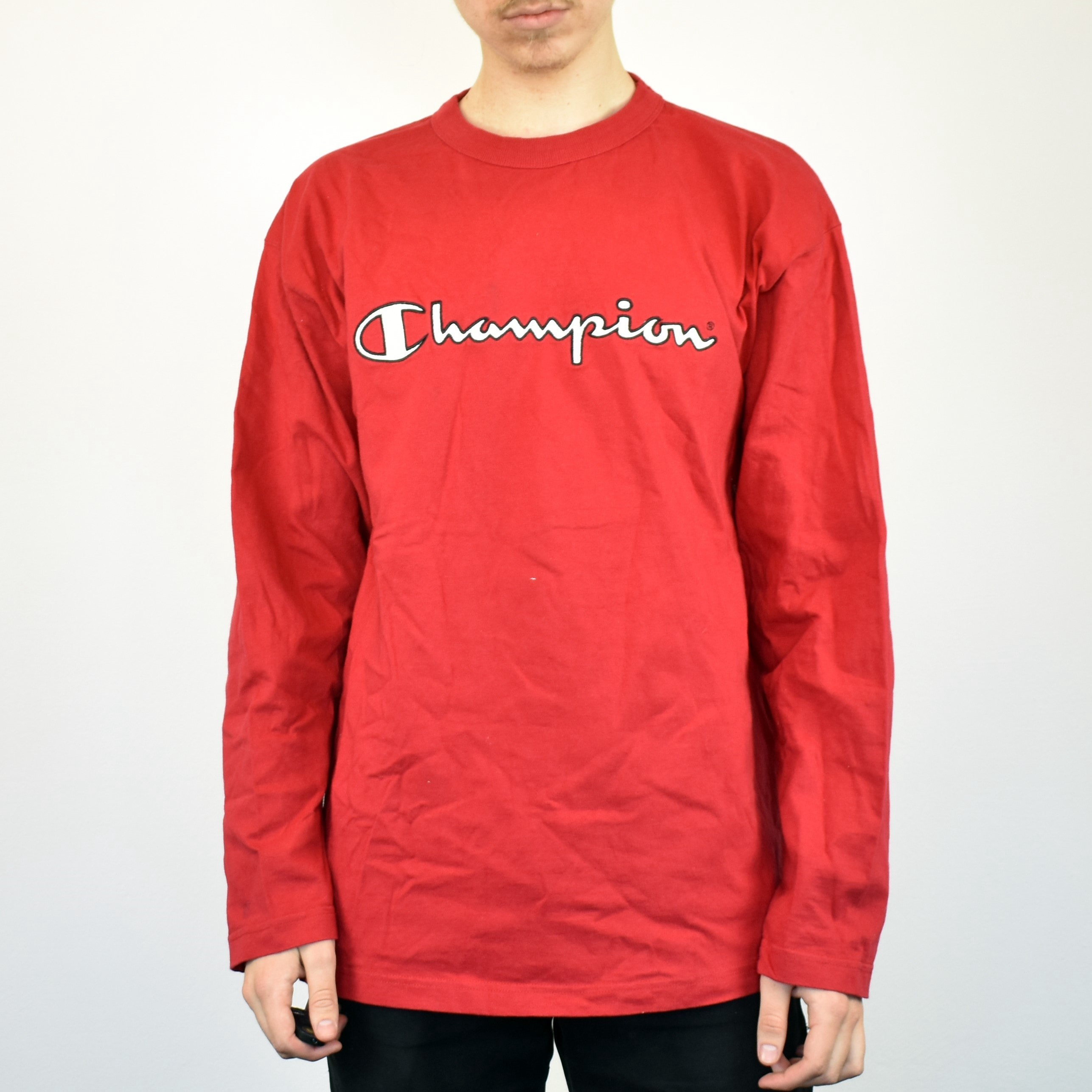 Unisex Vintage Champion longsleeve t-shirt in red has a big logo on the front size L