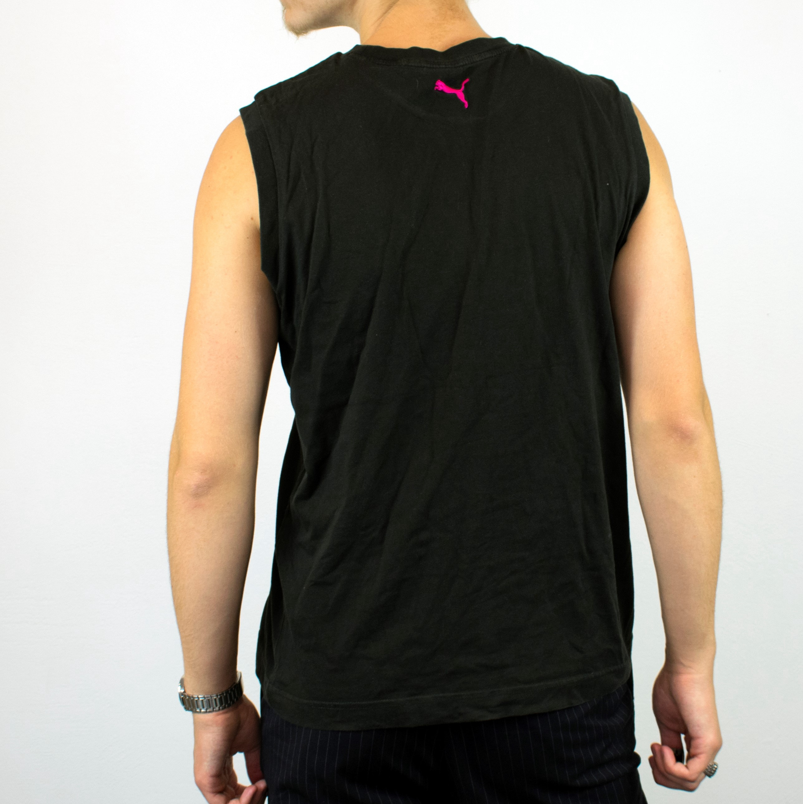 Unisex Vintage Puma sleeveless shirt in black has a big spellout on the front size M/L