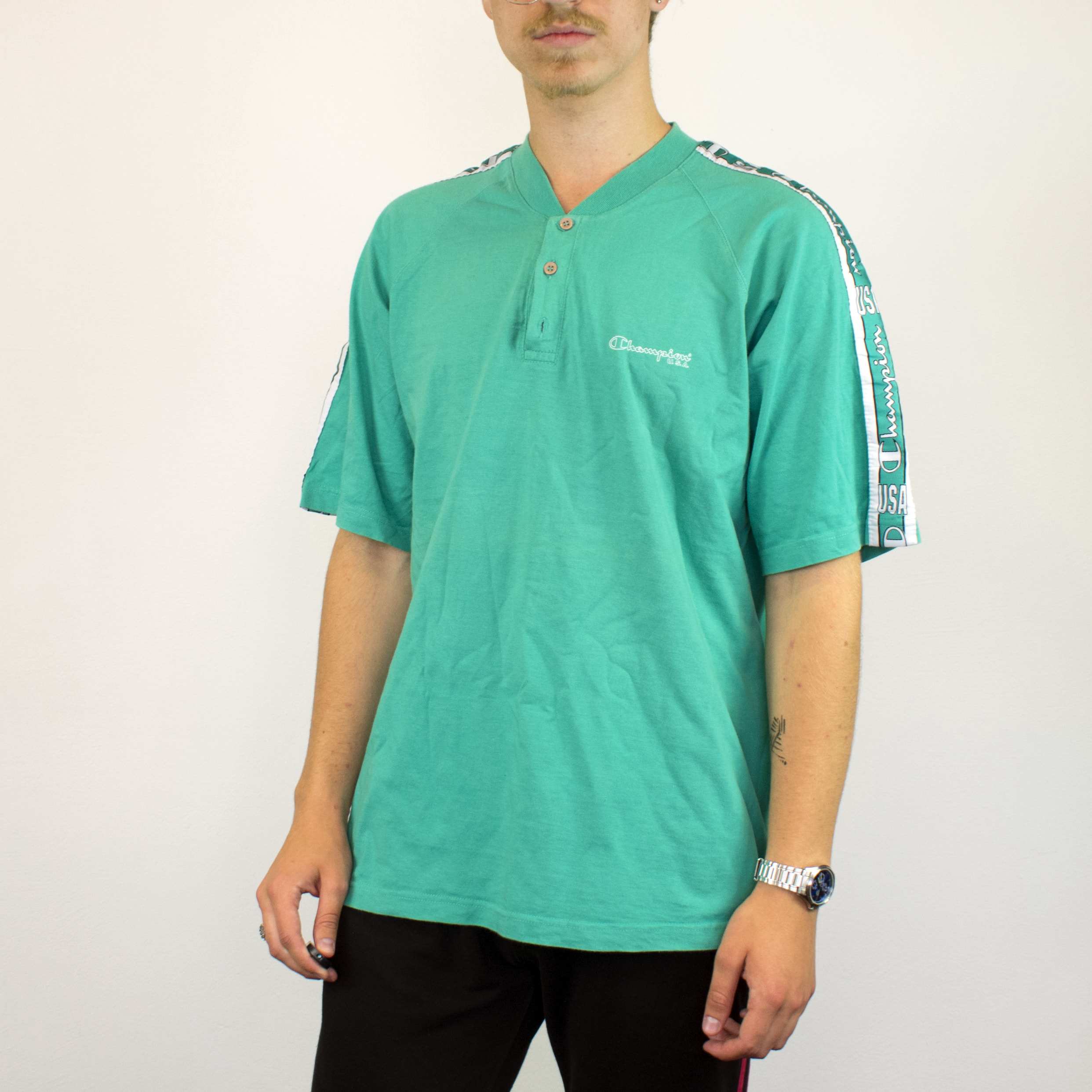 Unisex Vintage Champion polo shirt in cyan has a small spellout on the front size L