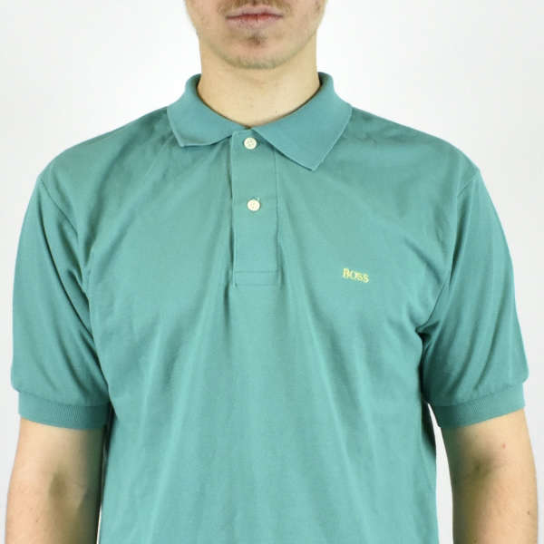 Vintage Hugo Boss polo shirt in cyan has a small logo on the front size M