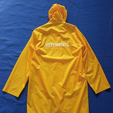 VETEMENTS YELLOW RAINCOAT JACKET