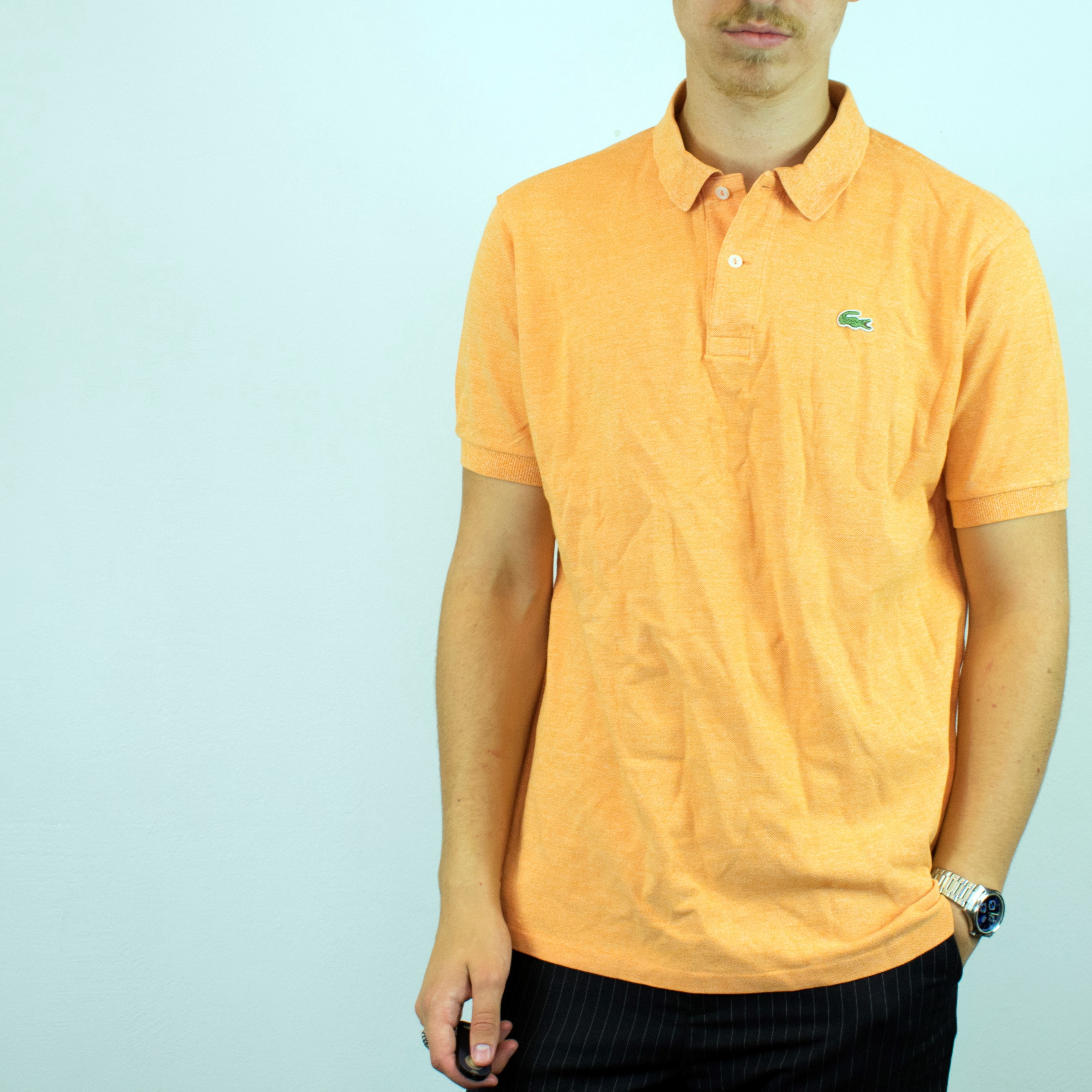Vintage Lacoste polo shirt in orange has a small logo on the front size L