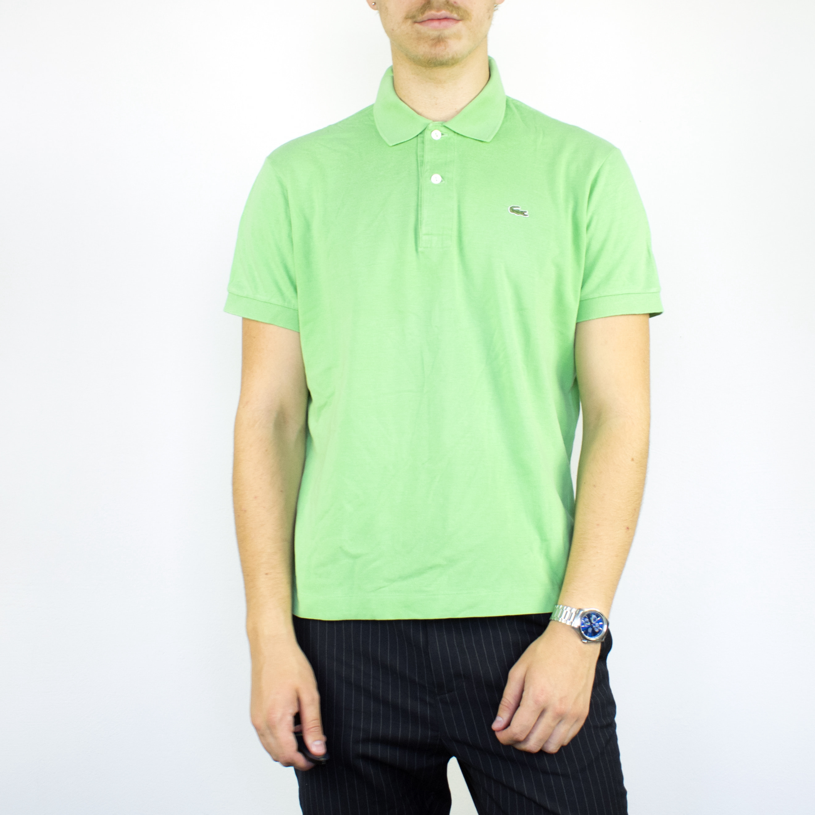 Unisex Vintage Lacoste polo shirt in green has a small logo on the front