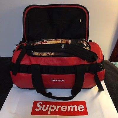 Supreme x The North Face Arc Logo Small Base Camp Duffle Bag in Red