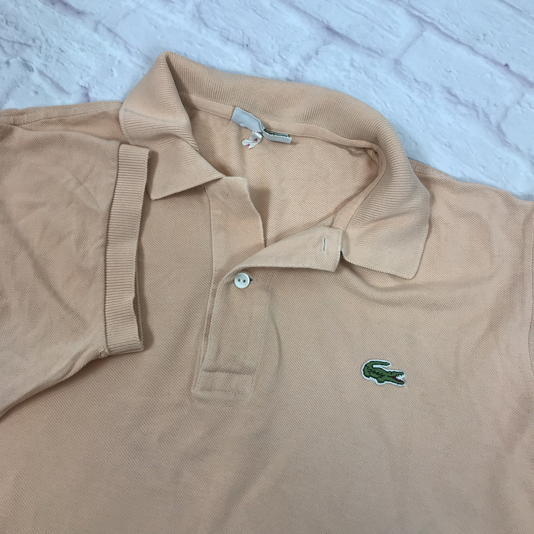 Unisex Vintage Lacoste polo shirt in pink has a small logo on the front