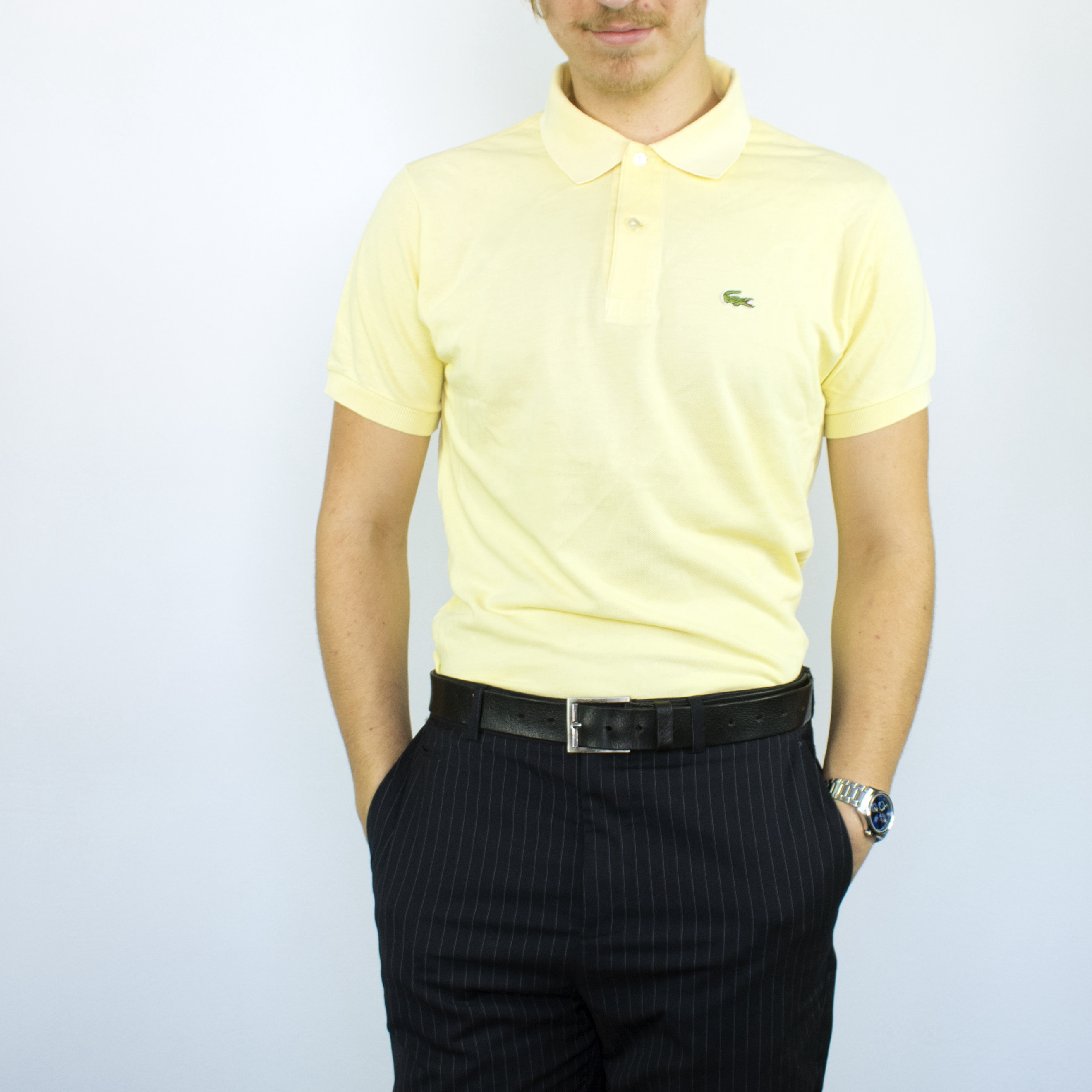 Unisex Vintage Lacoste polo shirt in beige has a small logo on the front