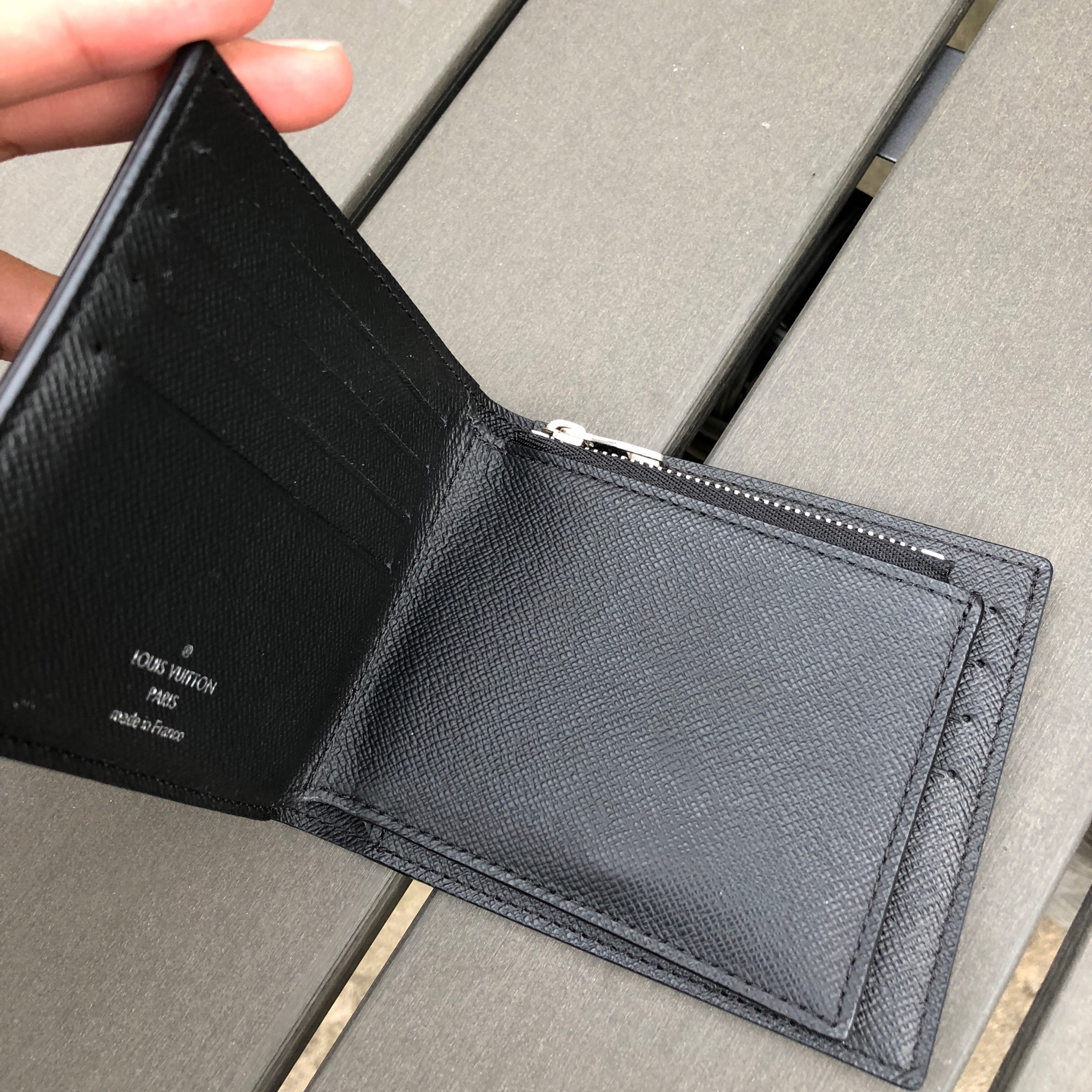 c119a45c35db Louis Vuitton Amerigo Wallet