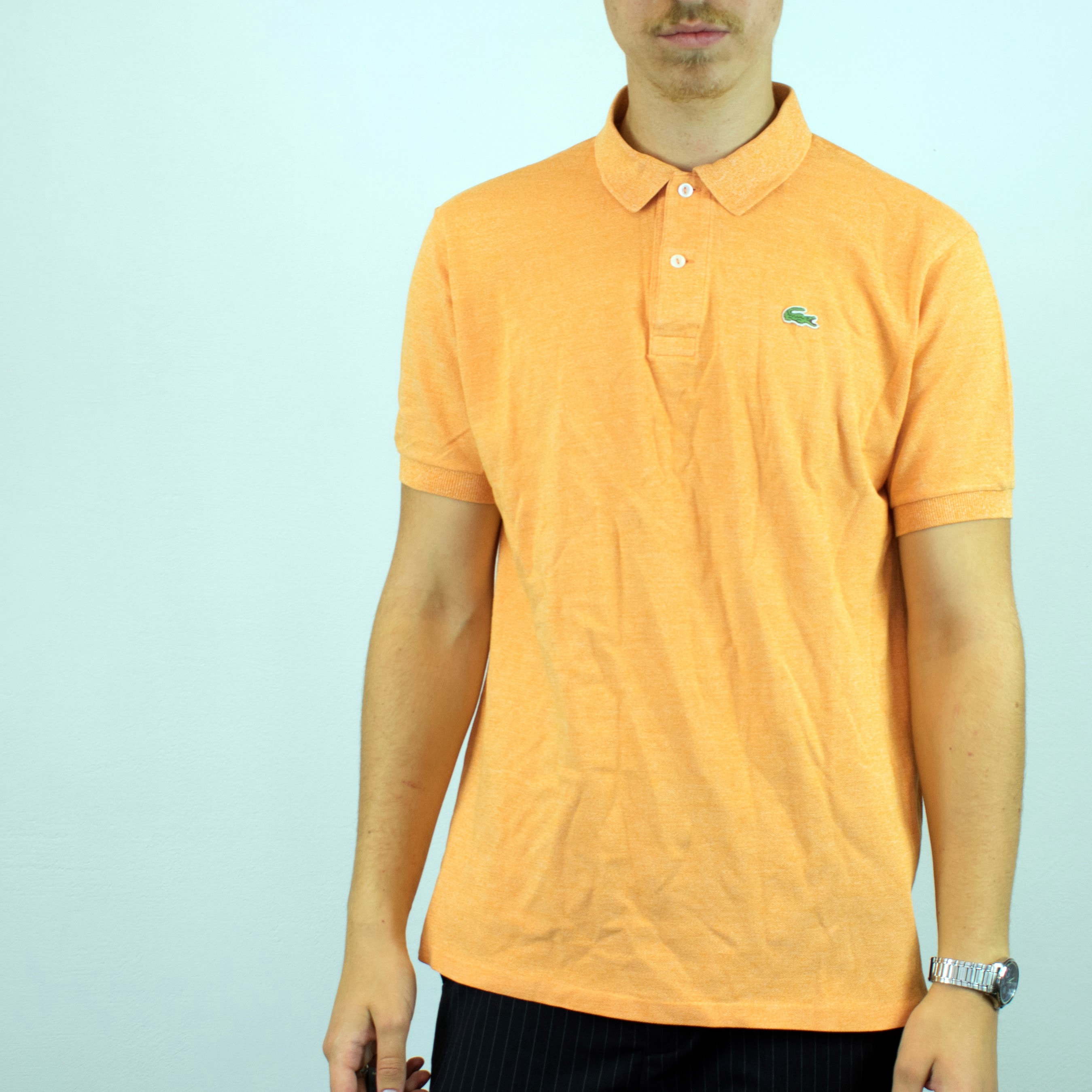 Unisex Vintage Lacoste polo shirt in orange has a small logo on the front size L
