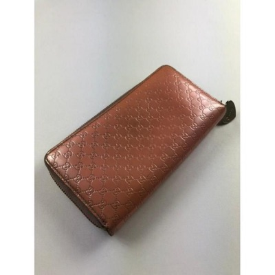 Gucci Gg Pink Monogram Leather Zippy Wallet
