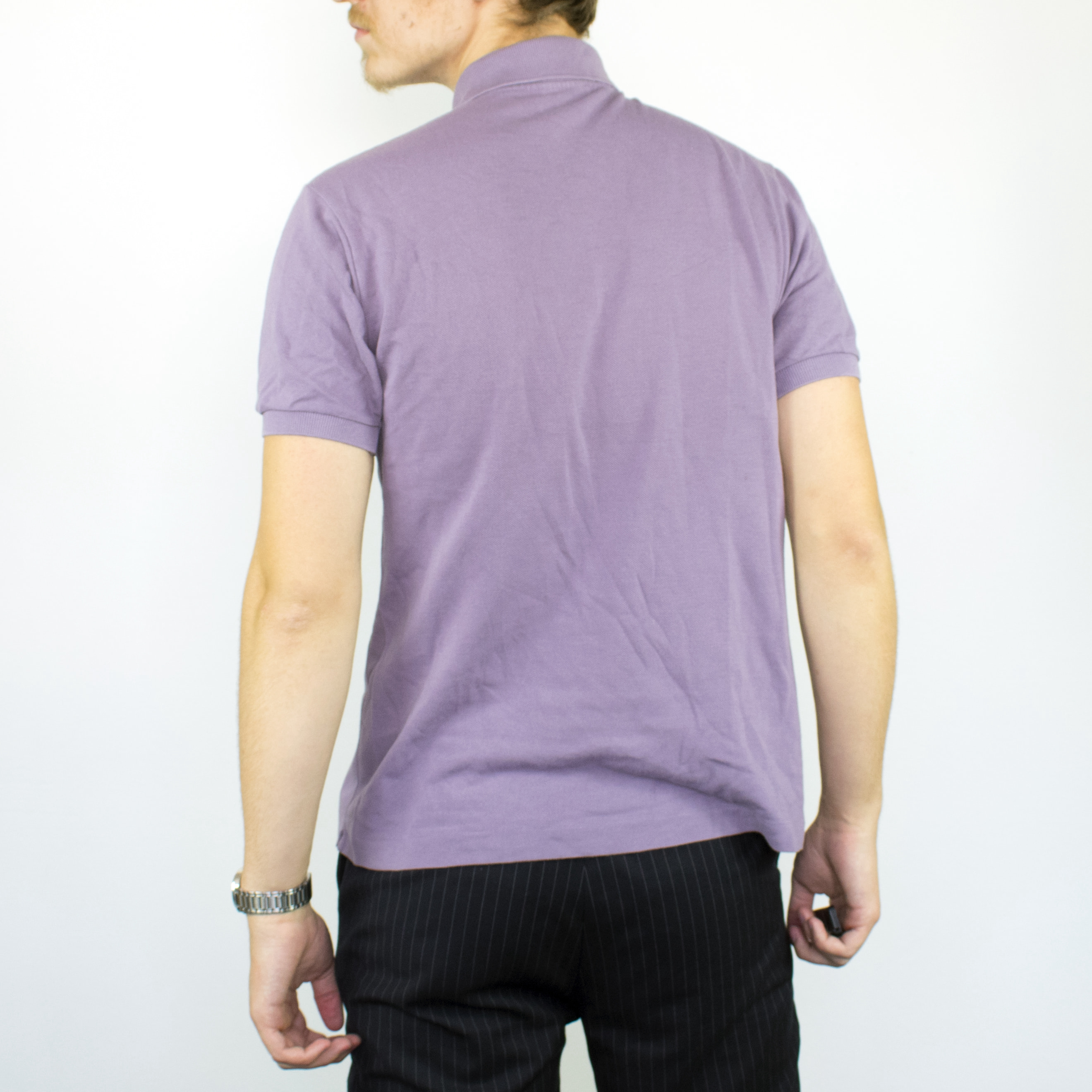Unisex Vintage Lacoste polo shirt in purple has a small logo on the front