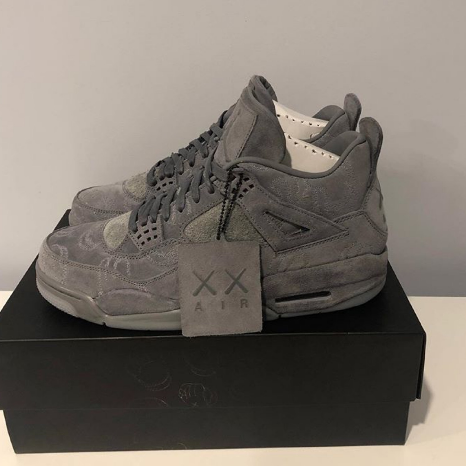 separation shoes 3fd8d c29a9 Nike Jordan 4 Kaws Grey