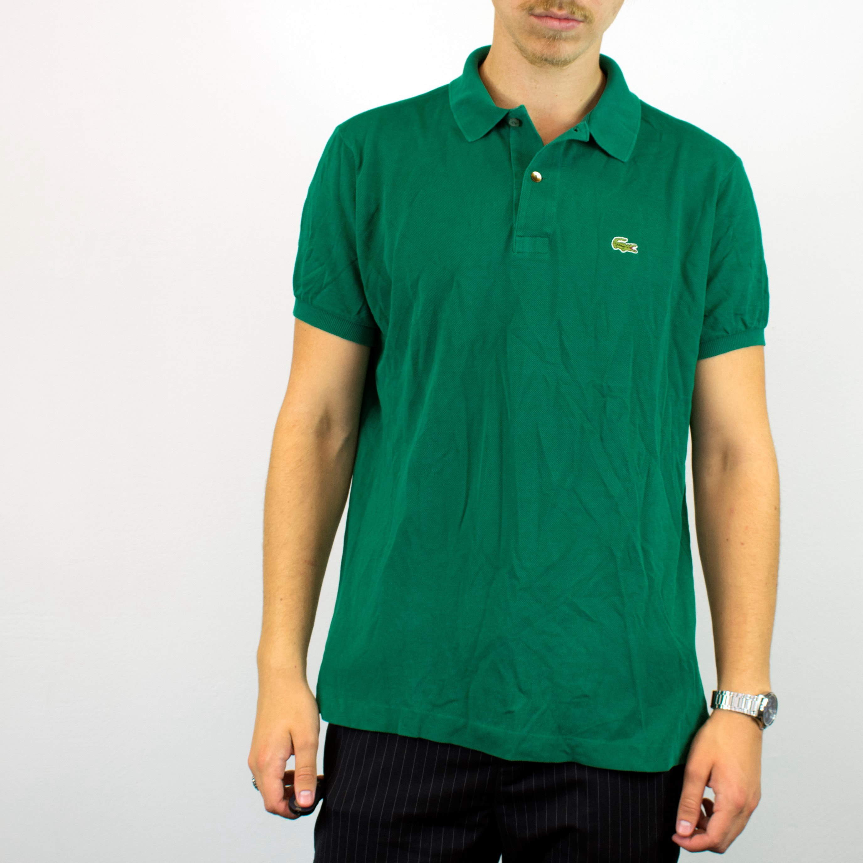 Unisex Vintage Lacoste polo shirt in green has a small logo on the front size L