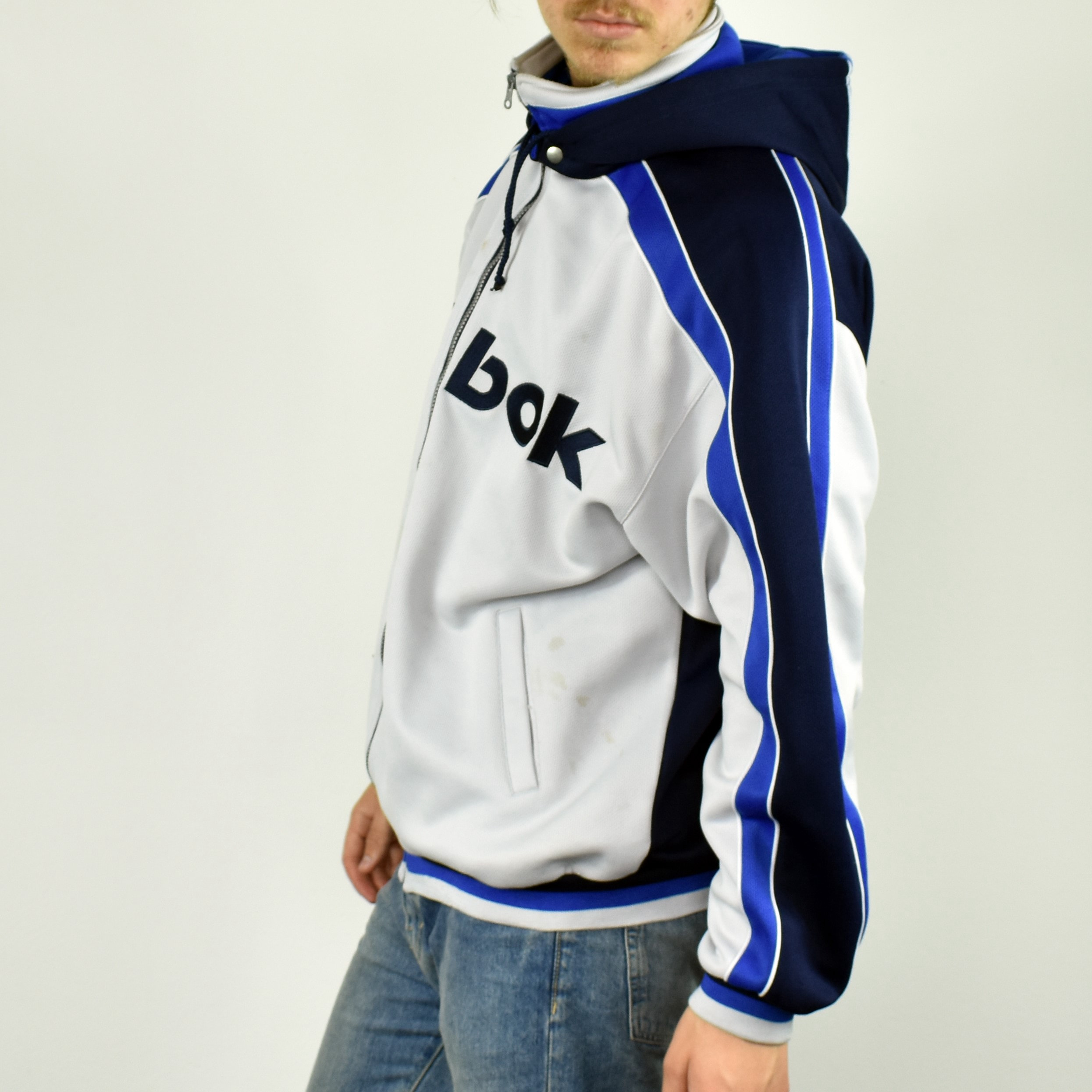 Unisex Vintage Reebok zip up hoodie track jacket in white and blue size M/L
