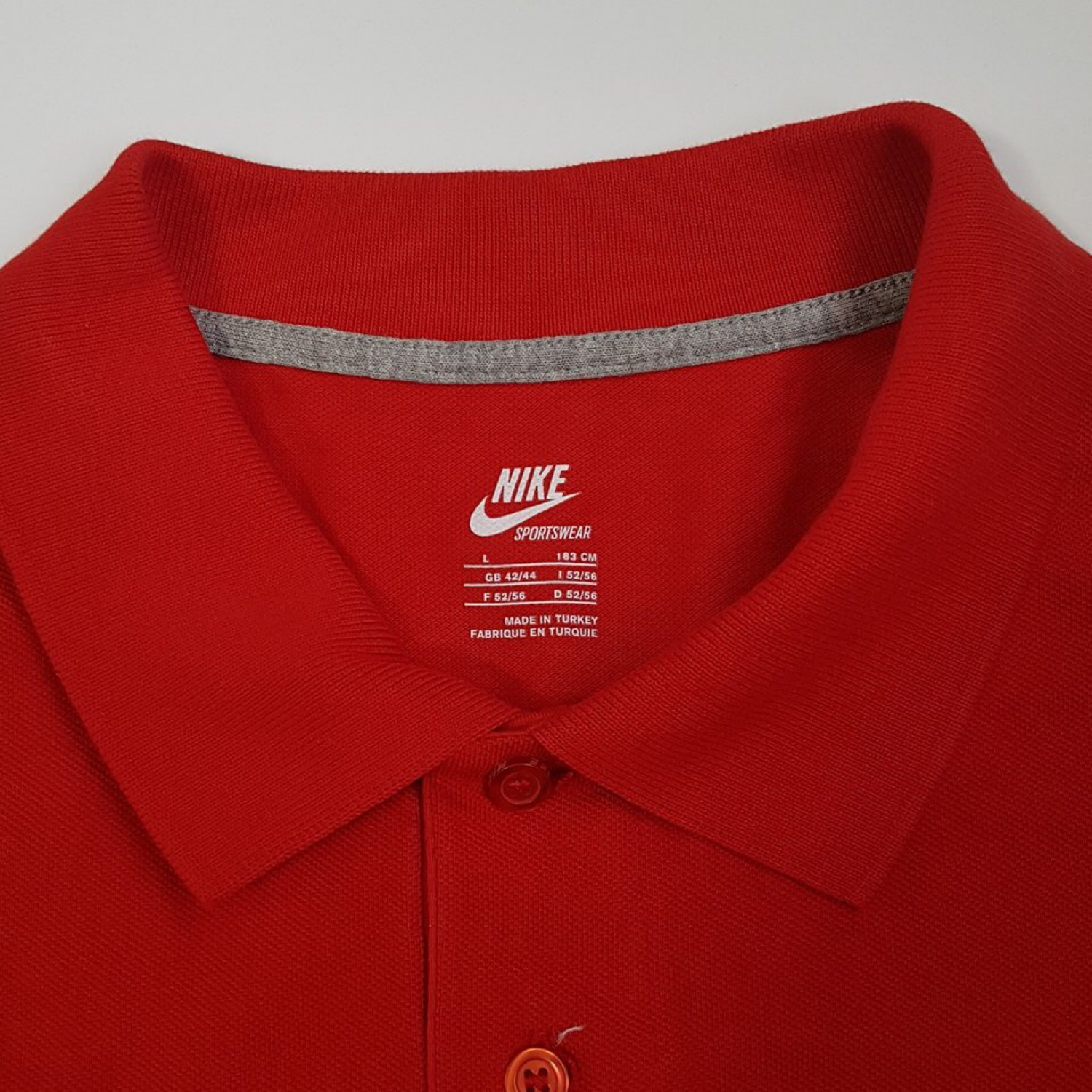 red nike polo shirt