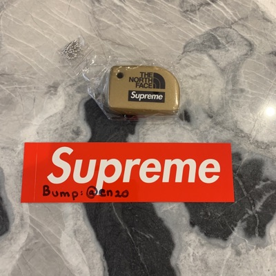 Supreme Gold North Face Key Ring