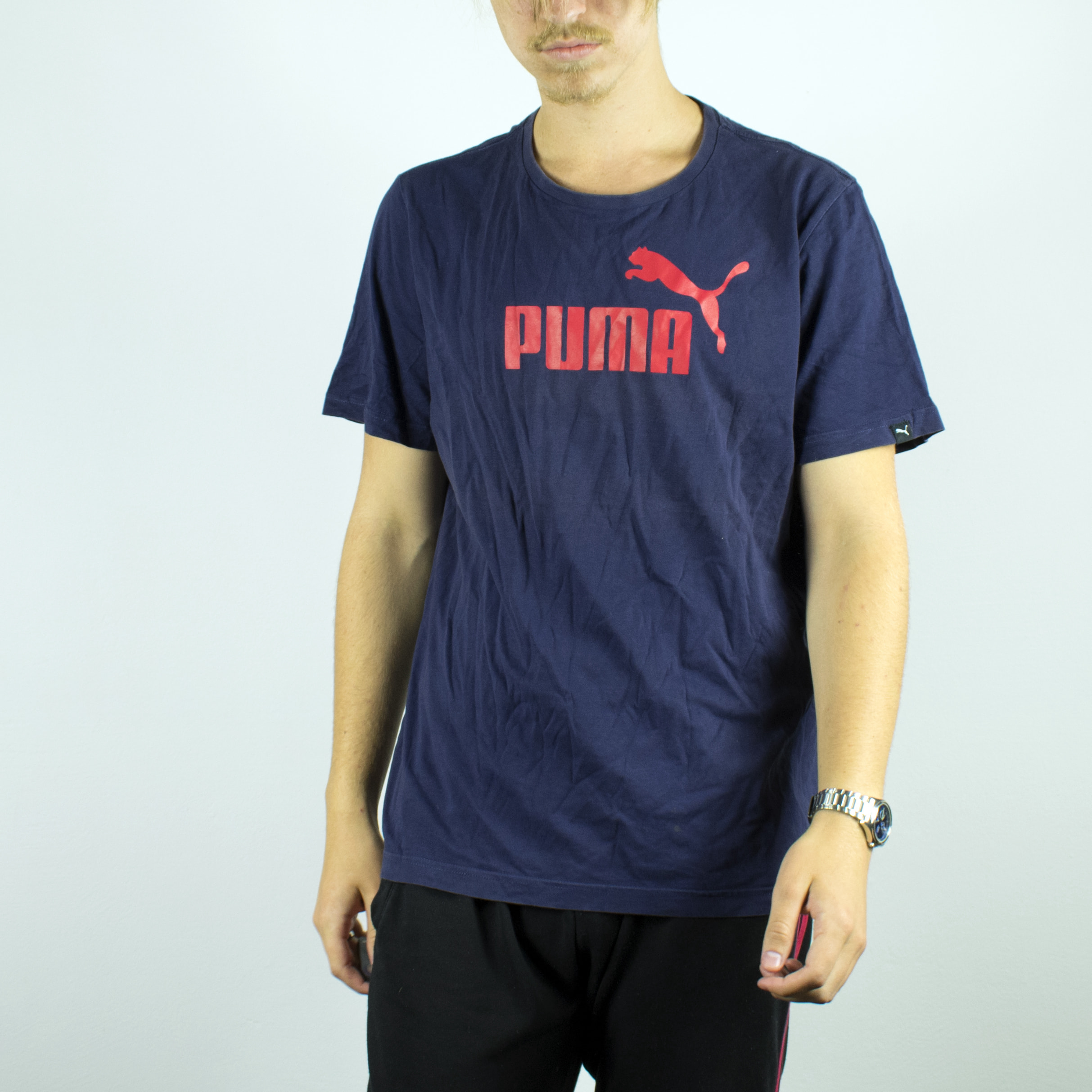 Unisex Vintage Puma t-shirt in navy blue has a big spellout on the front size M/L