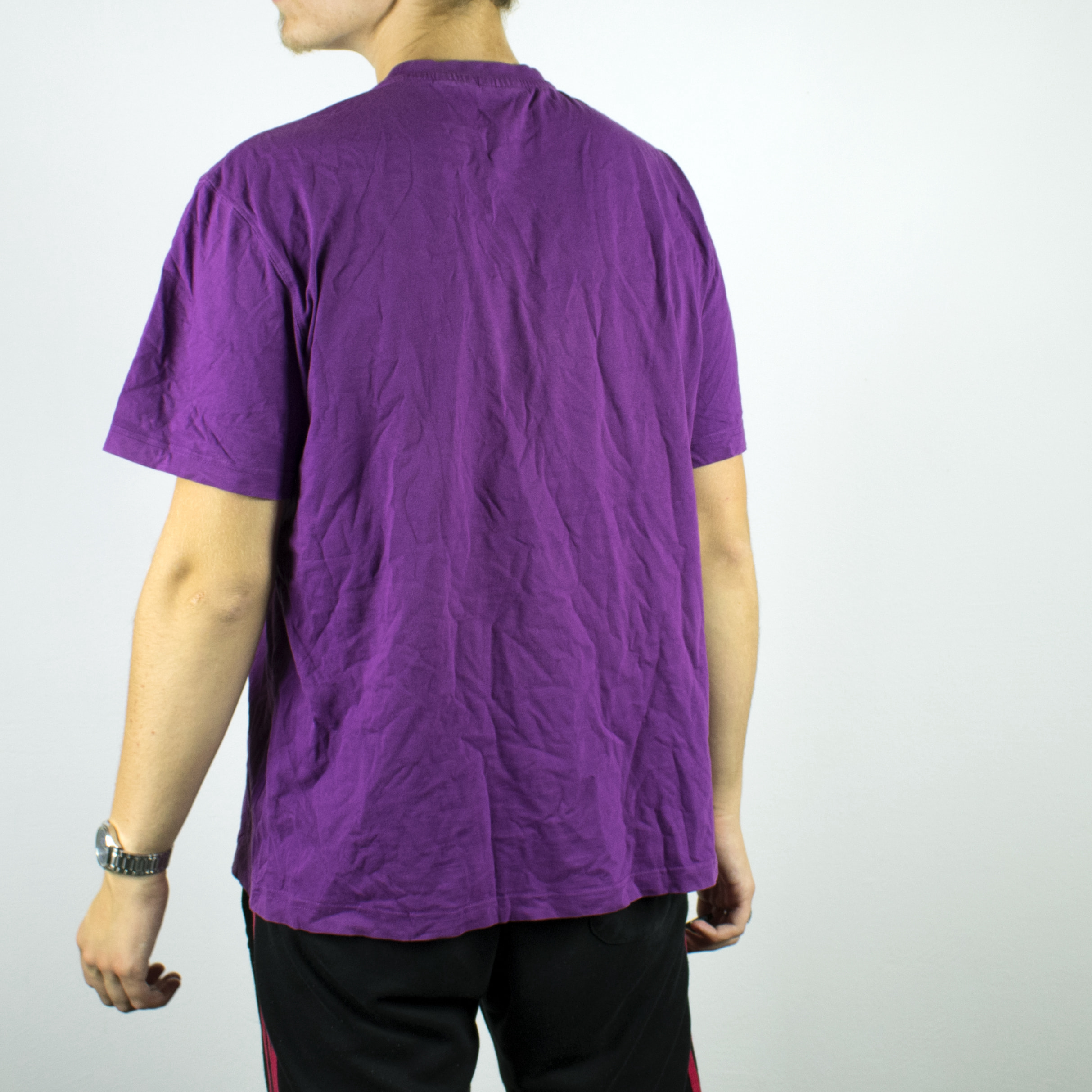 Unisex Vintage Fila t-shirt in purple has a design out of logos on the front size L