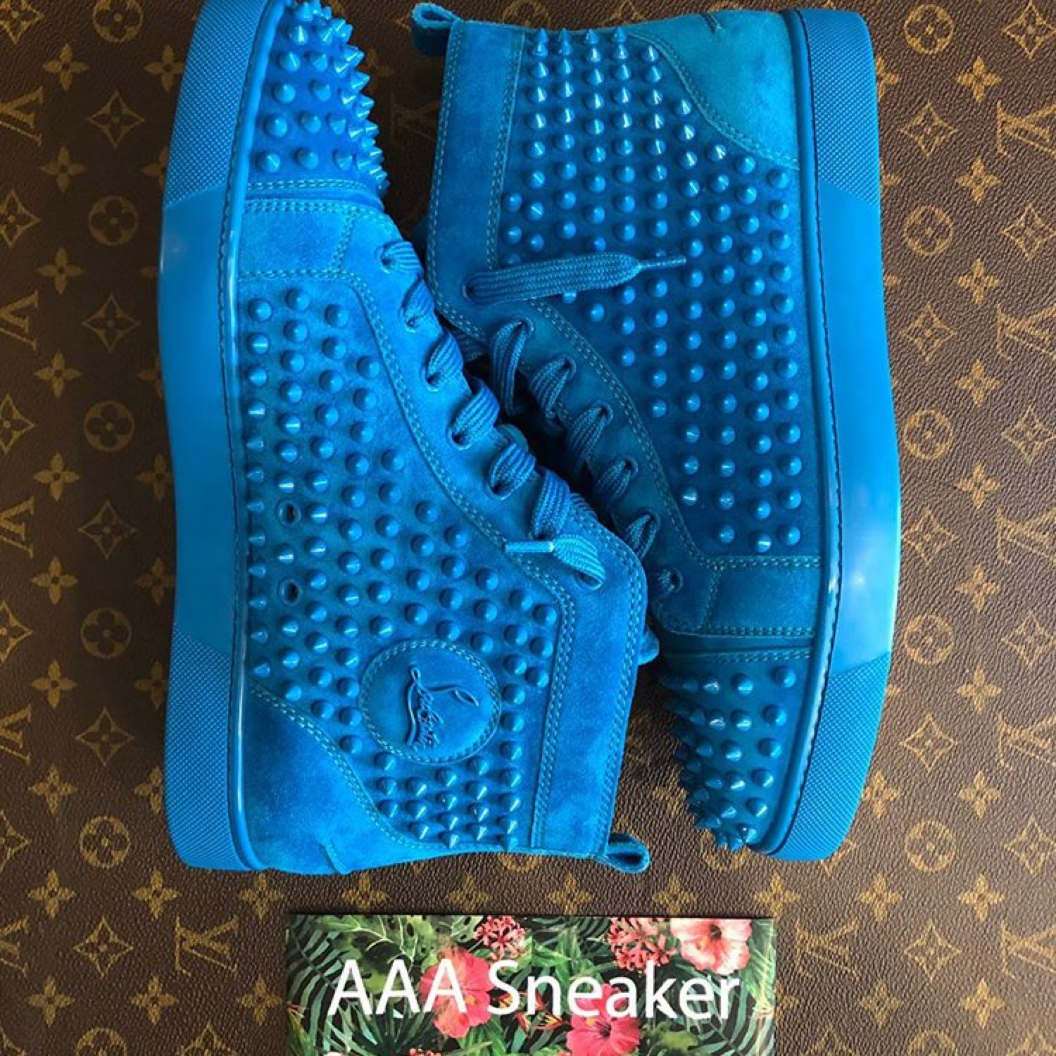 on sale aac0f 27e3a Christian Louboutin Blue Spiked Hi Top Sneakers