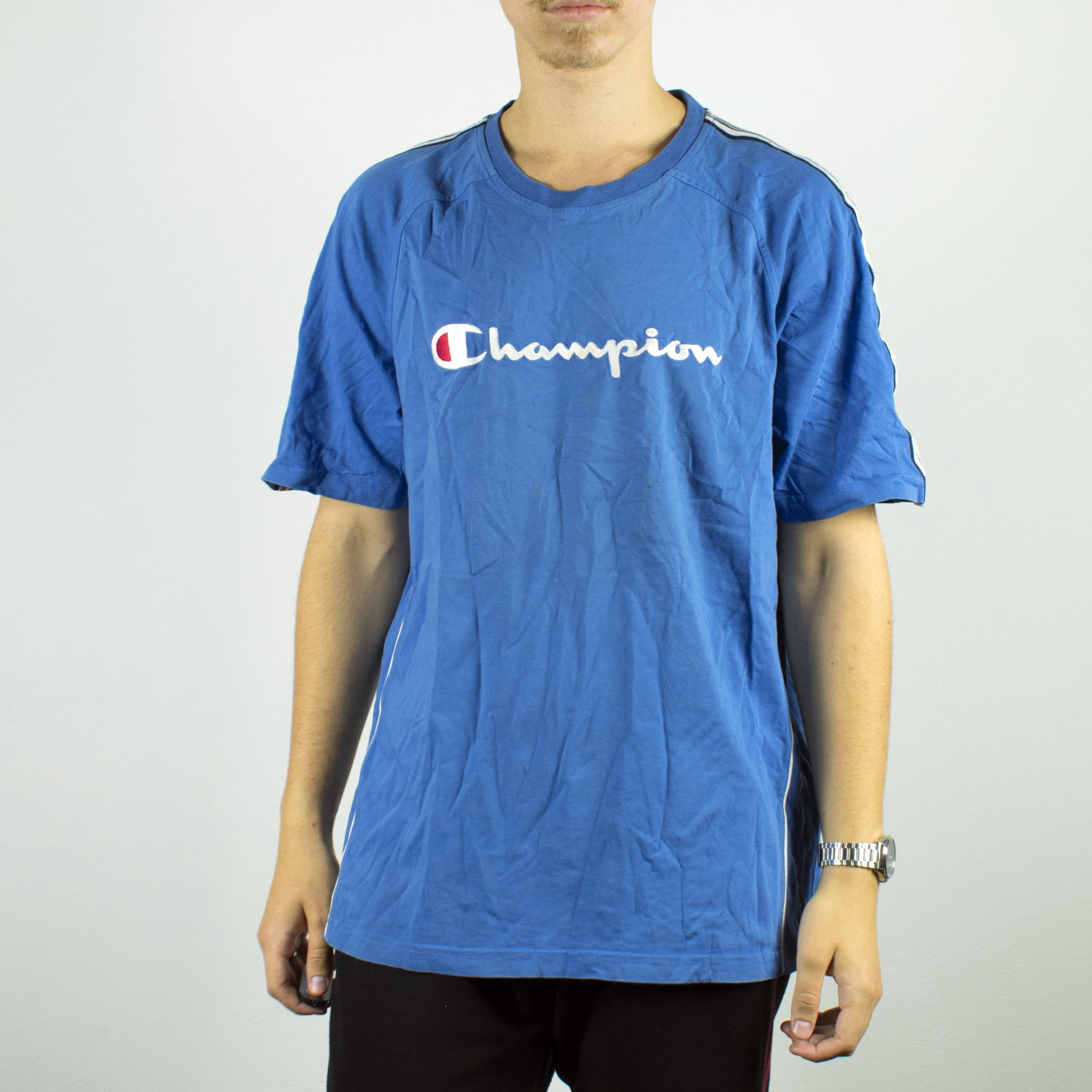 Unisex Vintage Champion t-shirt in cyan has a spellout on the front size L
